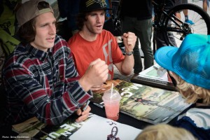One grom gets props from  McCaul and Semenuk when showing off his Kidsworx medal at the Trek tent.